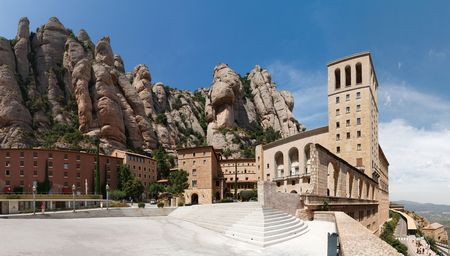 Montserrat Monastery is a spectacularly beautiful Benedictine Abbey high up in the mountains near Barcelona, Catalonia, Spain. Stock Photo