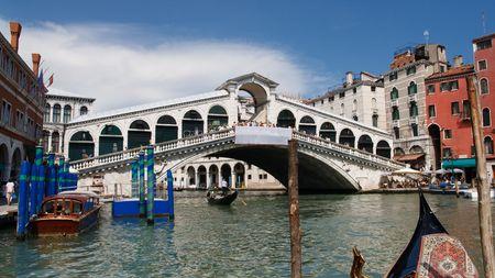 rialto bridge: View at the famous Rialto Bridge and the Grand Canal in Venice, Italy. Stock Photo