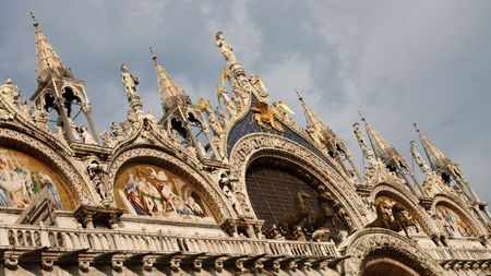 The artistic facade of the famous Basilica di San Marco (St. Marks Cathedral) at Piazza San Marco (St. Marks Square) in Venice, Italy photo