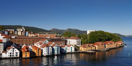 inlet bay: Colorful Houses in the City of Bergen, Norway, at the Fjord Shoreline. Clear blue Sky on a Summer Day. Stock Photo