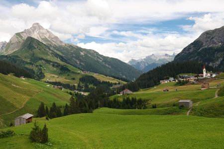 Idyllic Alpine Village in Vorarlberg, Austria. Green Meadows, Mountains (Alps) in the Background. Stock Photo - 5765928