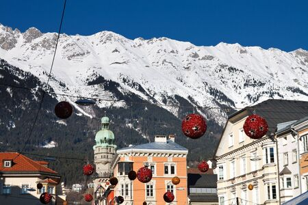 Cityscape of Innsbruck, Austria. Christmas Decoration. Snowy Mountains (Alps) in the Background.