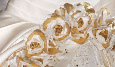 Close-up View of Details on a Beautiful Wedding Dress Ornamented with Roses photo