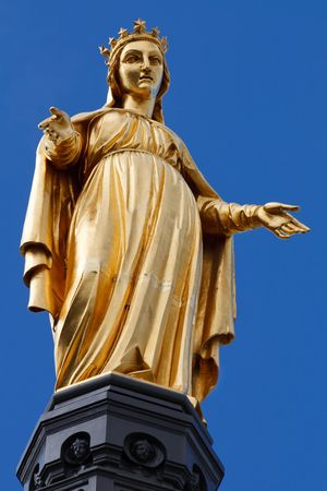 consecrated: Golden Statue of Virgin Mary  Saint Mary  Our Lady in Lyon, France. Clear Blue Sky in the Background.