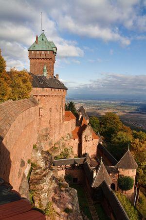 haut: Castle of Haut-Koenigsbourg, Alsace, France. Dramatic Cloudscape. Warm Light. Stock Photo