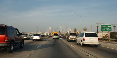 Los Angeles Traffic on Interstate 110 Freeway. Skyline of L.A. in the Background.