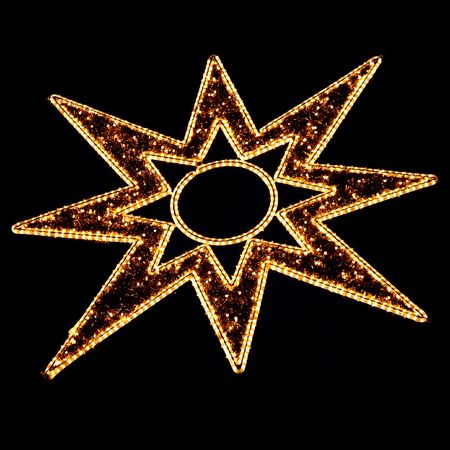 weihnachtsmarkt: Illuminated Christmas Star Decoration on Black at a Christmas Market (Weihnachtsmarkt) in Germany