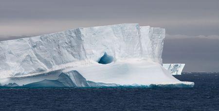 icescape: Huge Tabular Iceberg Floating in Bransfield Strait, Antarctic Peninsula, Antarctica Stock Photo