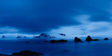 Twilight Scenery in Antarctica at Midnight. Dramatic Blue Light and Cloudscape. Stock Photo - 6124547