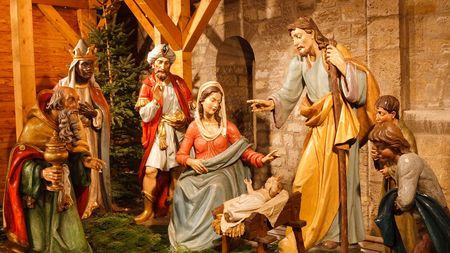 Christmas Nativity Scene with Three Wise Men Presenting Gifts to Baby Jesus, Mary & Joseph. Stock Photo