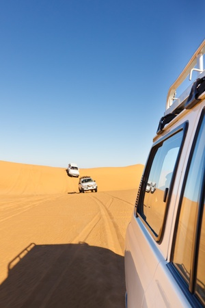sahara desert: Sahara Desert Safari - Off-road vehicles driving in the Awbari Sand Sea, Libya