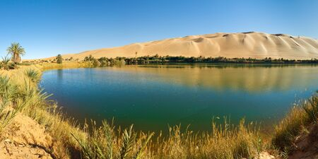 Gaberoun Lake - Idyllic oasis in the Awbari Sand Sea, Sahara Desert, Libya Stock Photo