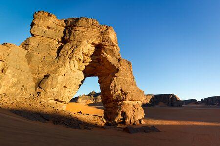 rock arch: Sunset at Forzhaga Arch - Huge natural rock arch - Akakus (Acacus) Mountains, Sahara, Libya