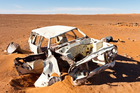 Abandoned wrecked car in Sahara Desert, Libya photo