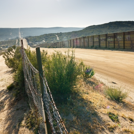 unlawful: USMexico border fence near Campo, California, USA Stock Photo