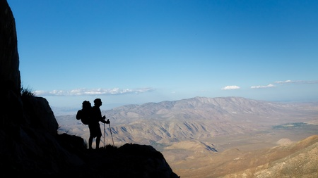 Desert Trekking Adventure - Silhouette of a hiker viewing Anza-Borrego Desert State Park, Southern California, USA photo