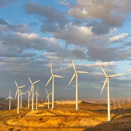 emissions: Windmills at Tehachapi Pass Wind Farm, California, generating clean renewable electrical energy without carbon dioxide emissions to fight climate change and global warming. Stock Photo