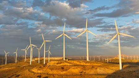 carbon dioxide: Windmills at Tehachapi Pass Wind Farm, California, generating clean renewable electrical energy without carbon dioxide emissions to fight climate change and global warming. Stock Photo