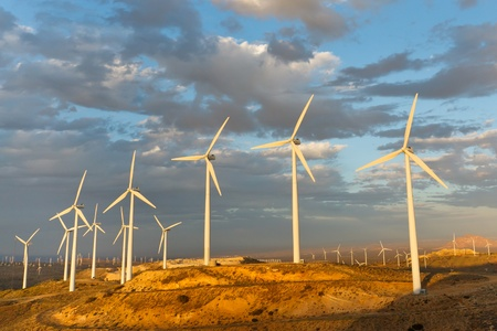 Windmills at Tehachapi Pass Wind Farm, California, generating clean renewable electrical energy without carbon dioxide emissions to fight climate change and global warming. Stock Photo