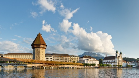 Chapel Bridge and Water Tower over Reuss River.  Cityscape of Lucerne, Switzerland Stock Photo - 9828339