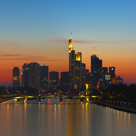 frankfurt: Frankfurts Skyline at night shortly after sunset. Frankfurt is the financial center of Germany. All major German banks are headquartered in the city. Stock Photo