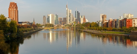 central bank: Panoramic view  of Frankfurts Skyline reflecting in the Main River. Frankfurt is the financial center of Germany. All major German banks are headquartered in the city.