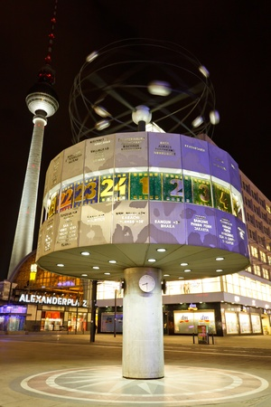 BERLIN - MAR 9, 2011:  The Urania-Weltzeituhr (World Clock) and TV tower at Alexanderplatz in Berlin, Germany, on March 9, 2011 at night.