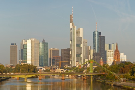main river: Skyline of Frankfurt reflecting in the Main River. Frankfurt is the financial center of Germany. All major German banks are headquartered in the city. Stock Photo