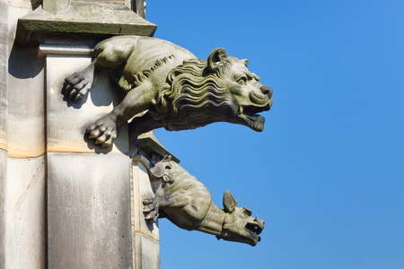 Gargoyle at the top of the steeple of Ulm Minster, the worlds tallest church (Ulm, Germany). photo