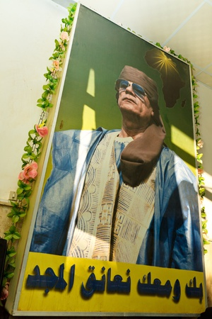 GHAT, LIBYA - Jan 10, 2011: A propaganda poster showing Colonel Muammar al-Gaddafi in a hotel in Ghat, Libya, on January 10, 2011. Gaddafi is killed nine month later by Libyan rebel fighters.