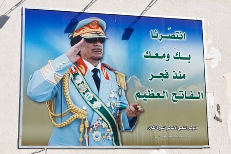 autocratic: TRIPOLI, LIBYA - Jan 16, 2011: A propaganda poster showing Colonel Muammar al-Gaddafi in Tripoli, Libya, on January 16, 2011. Gaddafi is killed nine month later by Libyan rebel fighters.