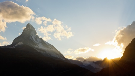 iconic: Matterhorn at sunset. The sun is setting behind Switzerlands most iconic mountain.