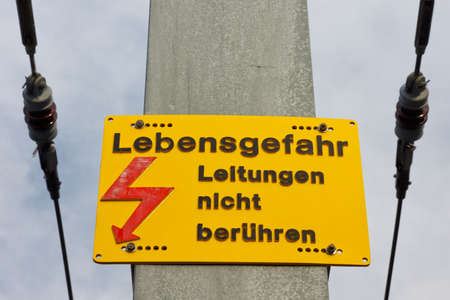 High voltage warning sign (in German).