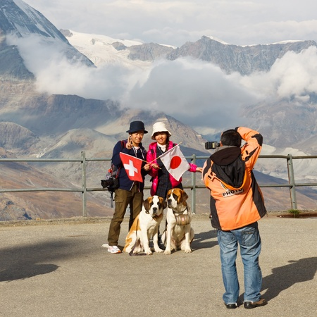 ZERMATT, SWITZERLAND - SEP 17: Japanese tourists have their picture taken at Matterhorn near Zermatt, Switzerland, on September 17, 2011. The iconic mountain is very popular with Japanese tourists.
