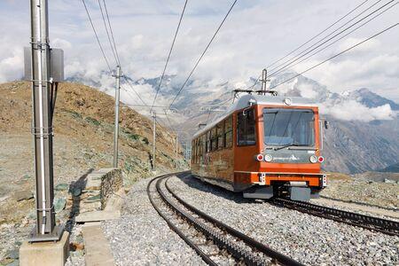narrow gauge: ZERMATT, SWITZERLAND - SEP 17: The Gornergratbahn, a narrow gauge mountain rack railway, approaches the Gornergrat summit station on September 17, 20111, near Zermatt, Switzerland.