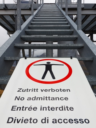 do not enter warning sign: No admittance sign. Keep out sign. No entry sign. Multilingual. Editorial
