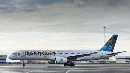 ed: REYKJAVIK, ICELAND - AUG 2: Iron Maidens airplane at the airport in Reykjavik, Iceland, on August 2, 2011 during the bands World Tour 2011. The uniquely painted airplane is known as Ed Force One.