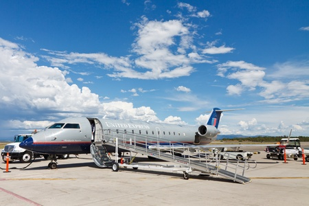 bombardier: DURANGO, CO - AUG 3: A United Express Bombardier CRJ200 regional aircraft is parked at Durango-La Plata County Airport on August 3, 2011. The CRJ200 is one of todays most commonly used regional jets.