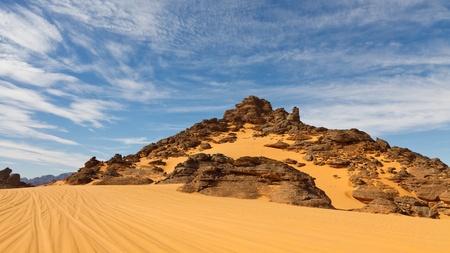 The Akakus Mountains are full of strange sandstone rock formations. Sahara Desert, Libya. Stock Photo - 11189316