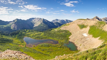 san juans: Beautiful scenery in the San Juan Mountains in Colorado. View of Taylor Lake from Indian Trail Ridge. Stock Photo