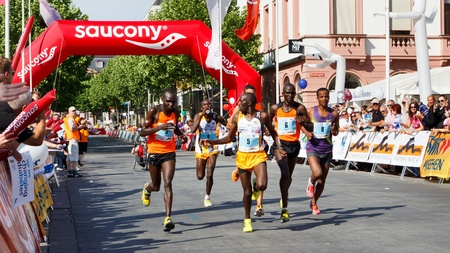 gutenberg: MAINZ, GERMANY - MAY 8: The leading group passes through Gutenbergplatz (13 km mark) at the Gutenberg Marathon on May 8, 2011 in Mainz, Germany. Among them, Tola Bane (8) of Ethopia, the later winner.
