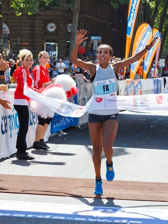 MAINZ, GERMANY - MAY 8: Asha Gigi Roba of Ethopia crosses the finish line to win the Gutenberg Marathon on May 8, 2011 in Mainz, Germany. 9,500 runners participate in the event. Stock Photo - 11230183