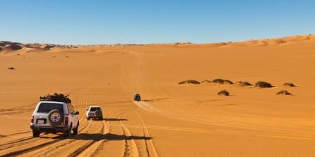 libyan: Desert Safari - Off-road vehicles driving in the Sahara Desert, Libya Stock Photo