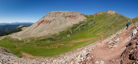 san juans: Hiker on the Colorado Trail climbs up to Blackhawk Pass in  the San Juan Mountains, Colorado.