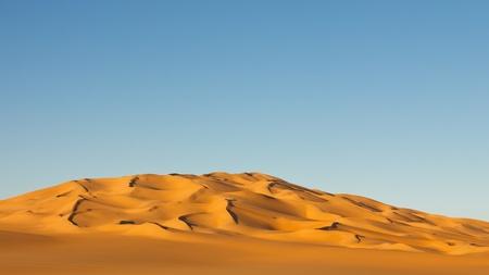 Sand sea in the Sahara Desert in Libya shortly before sunset. photo