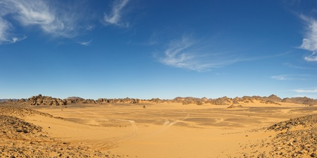 sahara desert: Panorama of a vast valley in the Akakus Mountains, Sahara Desert, Libya Stock Photo