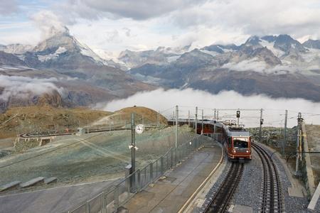 narrow gauge: The Gornergratbahn, a narrow gauge mountain rack railway, approaching the Gornergrat summit station. Matterhorn in the background.