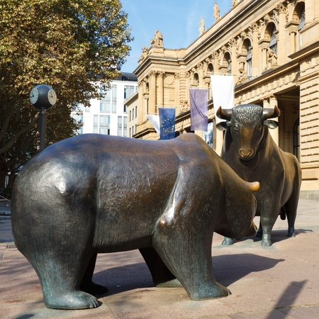 The struggle between bulls and bears symbolizing rising or falling financial markets. photo