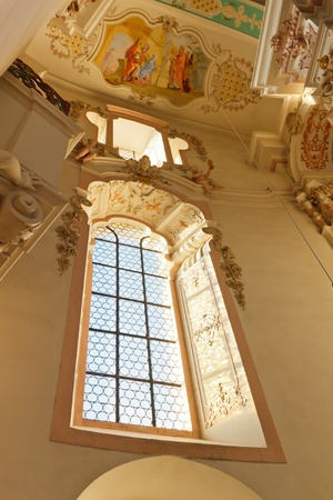 Window at baroque church in Steinhausen, Germany. Stock Photo - 12657636
