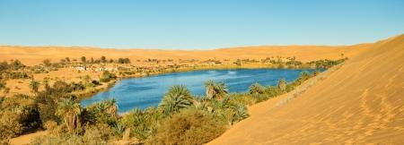 Sahara Oasis Panorama - Gaberoun Lake, Libya Stock Photo